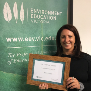 Deputy Principal pictured with Excellence Award